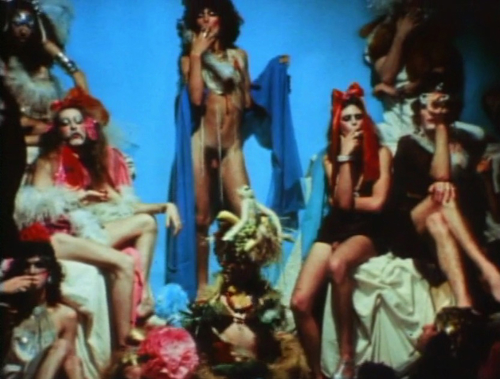 The Cockettes on set. Hibiscus is in the middle with exotic fruits. A still from Luminous Procuress (1971) A FILM BY STEVEN ARNOLD. Colour, Sound, 74mins, 16mm.