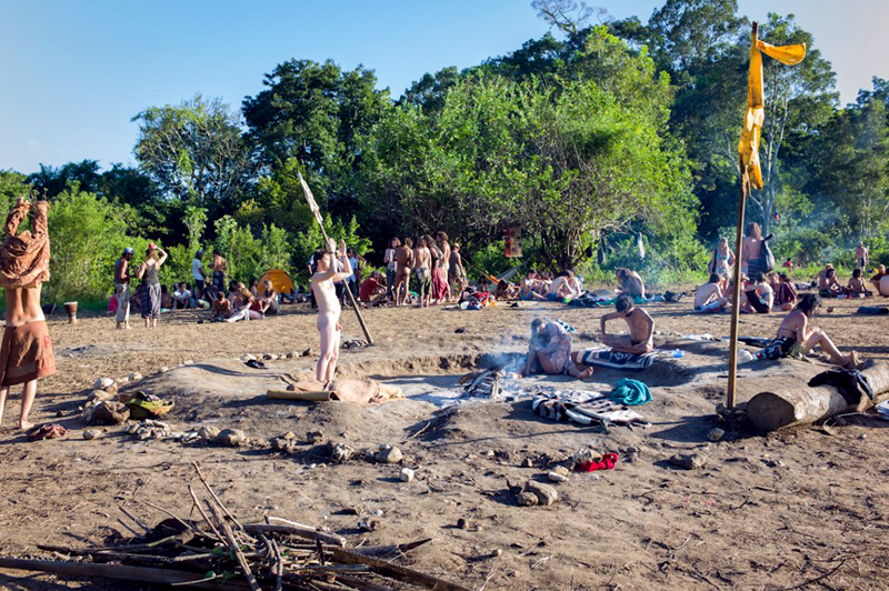 People around the sacred fire in the main circle area.