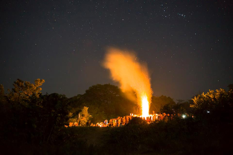 Night at the main fire in the jungle surrounding Palenque.