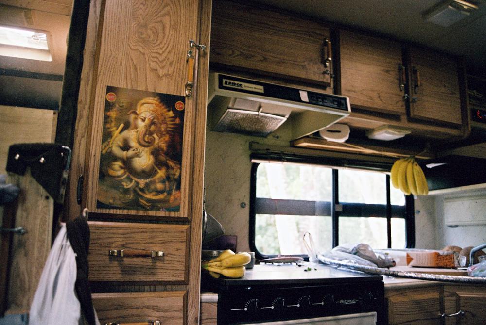 Ganesh with bananas in the kitchen of Garett's solar powered kitchen.