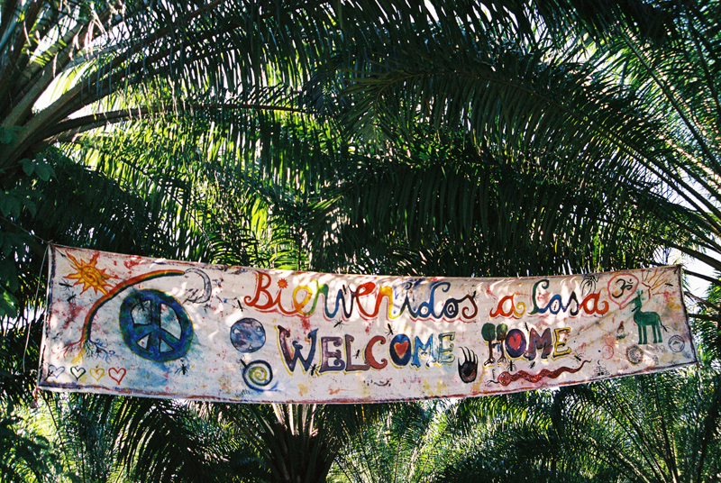 The Welcome Home sign at the entrance of the Rainbow Gathering.
