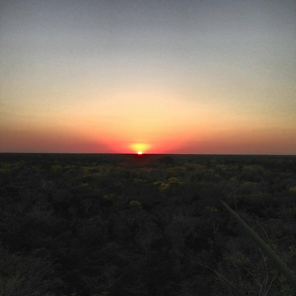 Enchanting sunset over the jungle as seen from the top of Ikil Pyramid.
