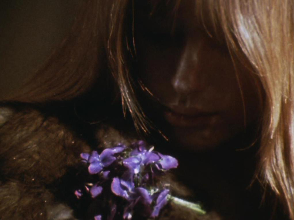 Lilith (Marianne Faithfull) with flowers. A still from Lucifer Rising (1966-1980), a film by Kenneth Anger. Colour, 16mm, 28mins.