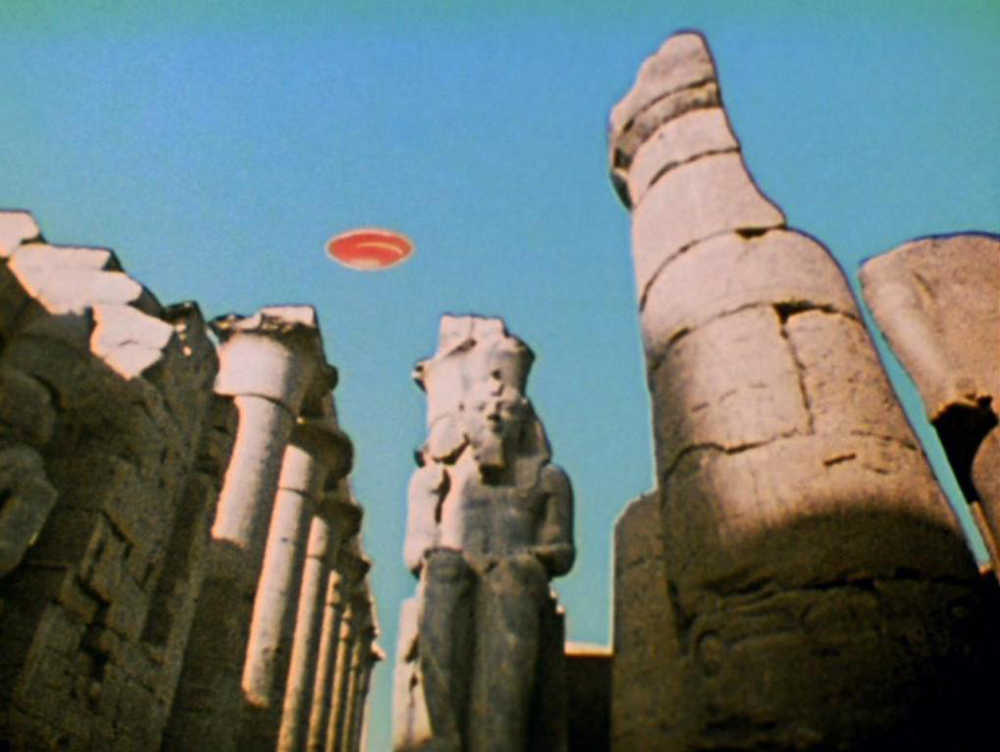 A UFO appearing over Luxor, Egypt. A still from Lucifer Rising (1966-1980), a film by Kenneth Anger. Colour, 16mm, 28mins.