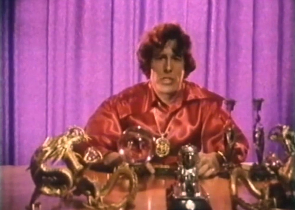 "KENNETH ANGER at his altar during an interview in the documentary portrait 'Kenneth Anger - Magier des Untergrundfilms [Magician of Underground Film] by Reinhold E. Thiel, 1970. ""And so he built a sort of altar, behind which he made his statements, robed as a magician and artist"", says Thiel of this particular moment."