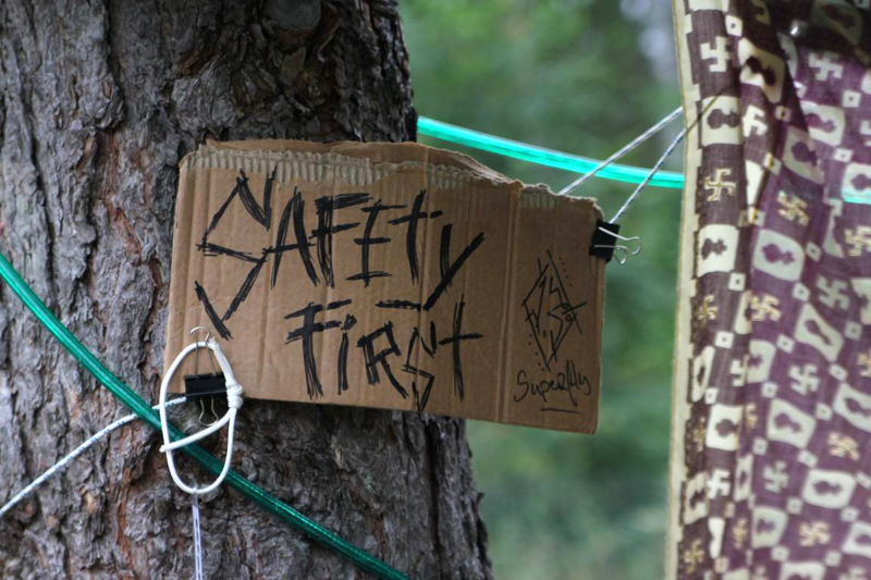 A sign on a tree by Superfly Suspension Crew at the 2014 annual Superfly Summer Camp. Photo Martin Villiam Jensen.