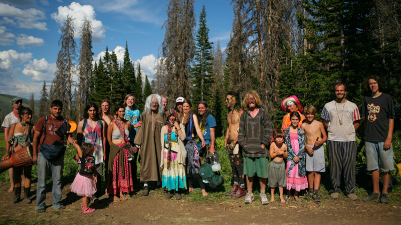 People of the Rainbow at the USA Rainbow Gathering in the Uinta Forest, Utah. Photo Tyler Coleman.