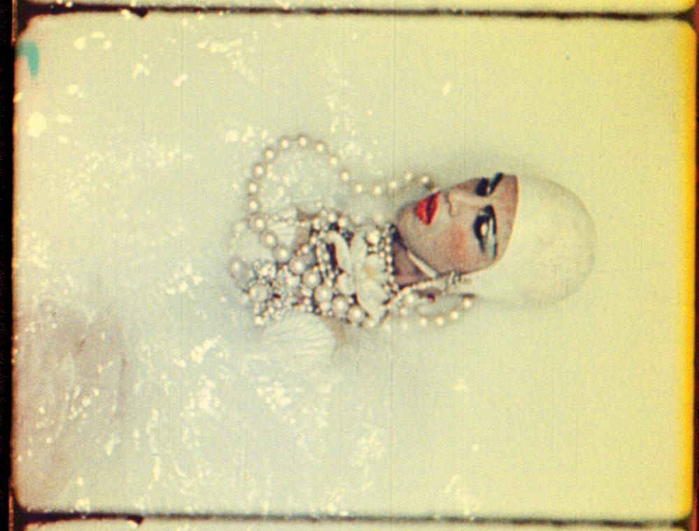 An exotic bath. A still from Normal Love (1963) A film by JACK SMITH. Colour, Sound, 16mm, 103 mins.