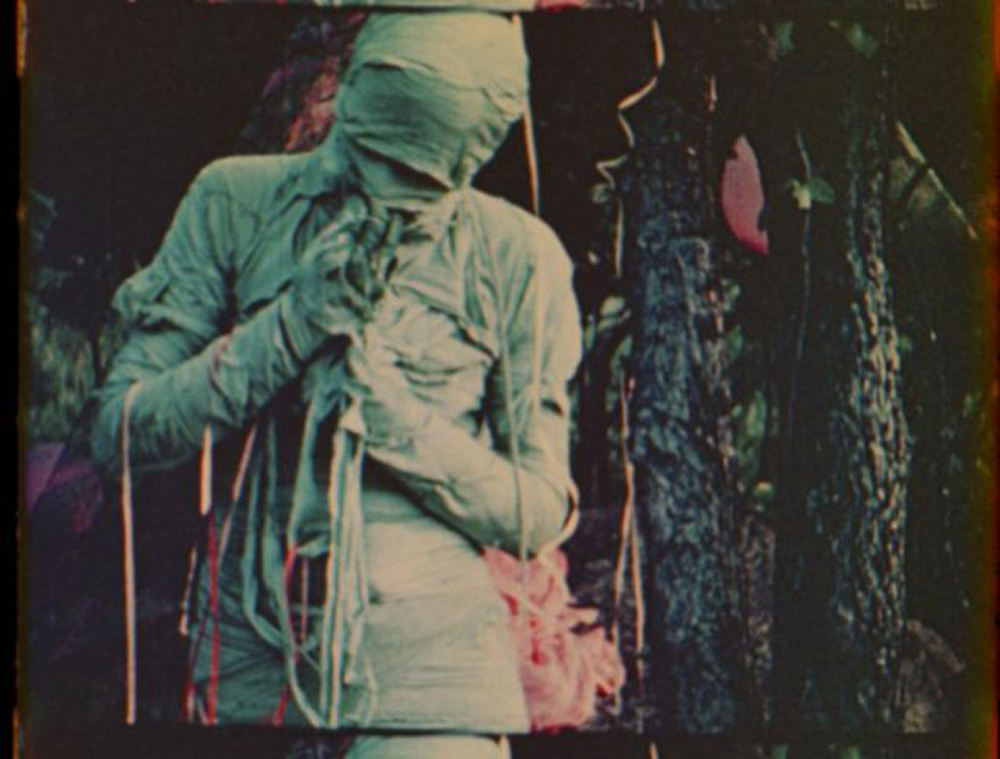 The Mummy. A still from Normal Love (1963) A film by JACK SMITH. Colour, Sound, 16mm, 103 mins.