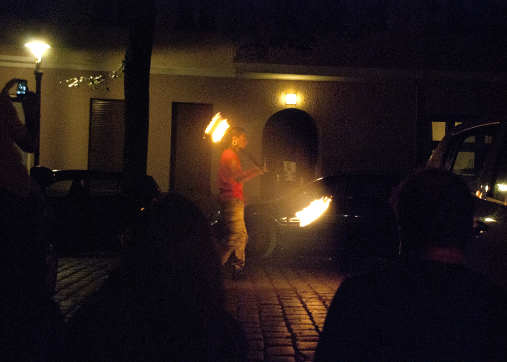 The Third Eye's Mexican friend Motor playing fire in the street in front of AKA Galerie.