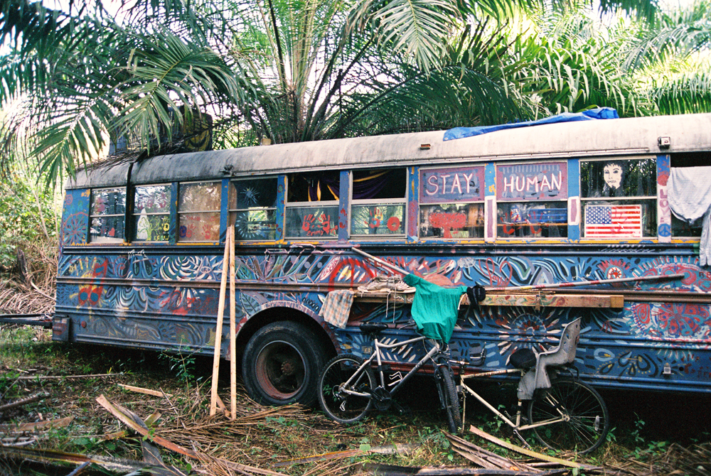 STAY HUMAN. Side view of the The Dream Machine from USA. All these photos were taken after the torrential rains of 21 December turned the jungle grounds into muddy swamps.