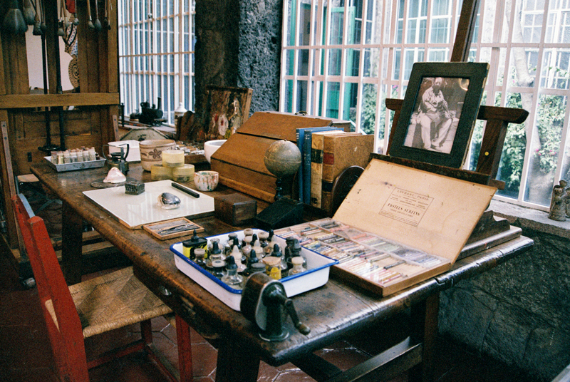 Frida Kahlo's desk with a portrait of Diego Rivera.