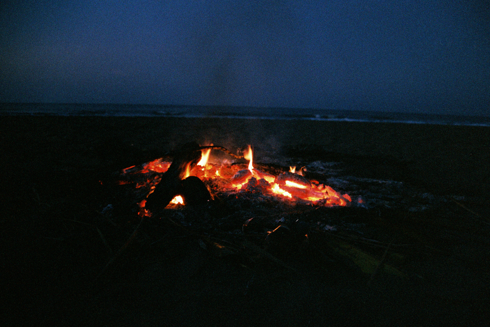 Our fire at night, we camped on the beach.