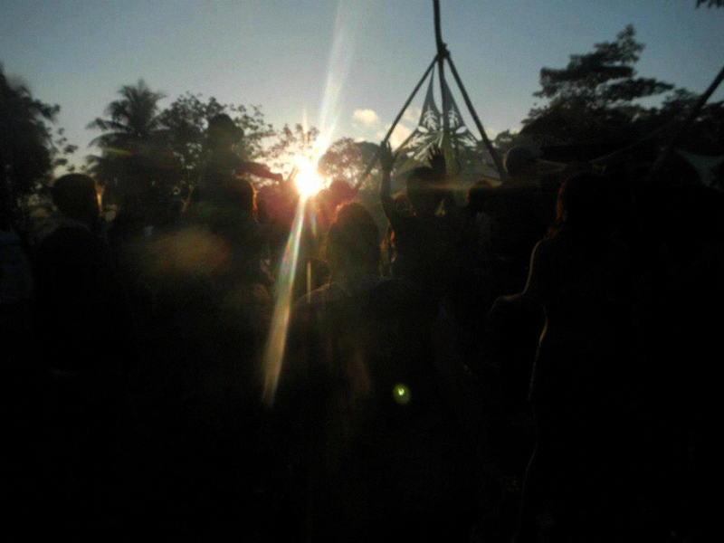 The sun setting over the powerful jungle around the Main Stage.