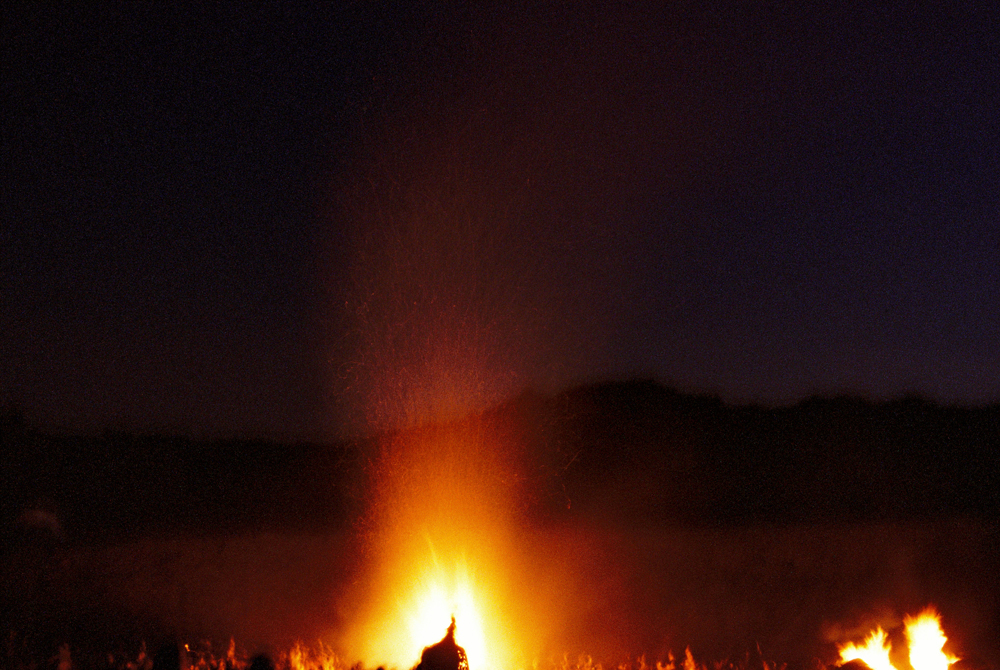 The sacred fire burning through the night.