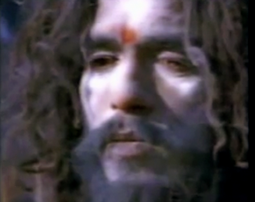 Baba with ash during a ritual with his guru. A still from Sadhus: India's Holy Men/Living With The Dead (1995), a film by Rajesh Bedi and Naresh Bedi. Colour, 50 mins.
