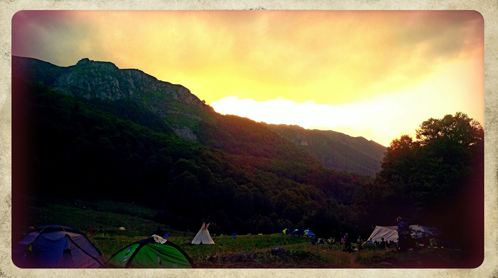 Late afternoon with the sun setting over the European Rainbow Gathering.