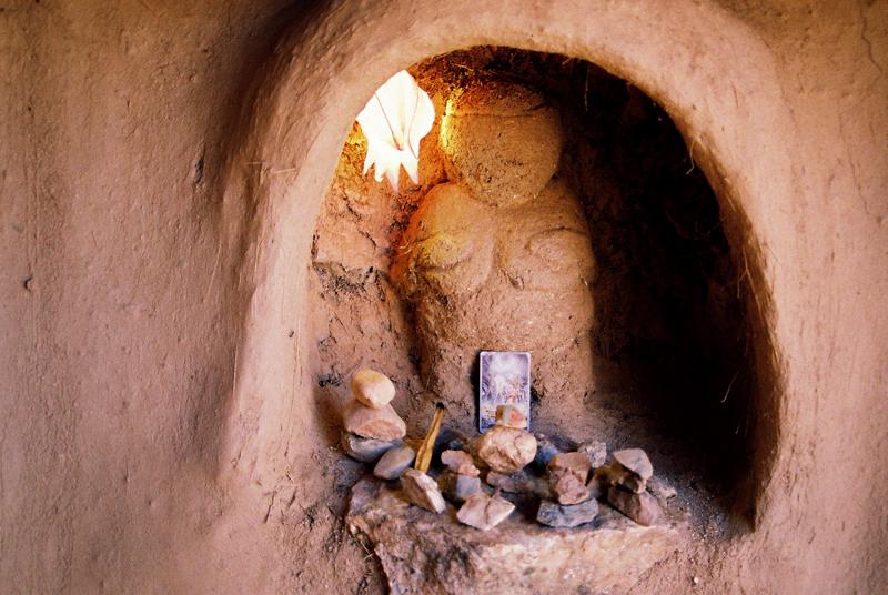 A clay altar around the Sacred Fire area.