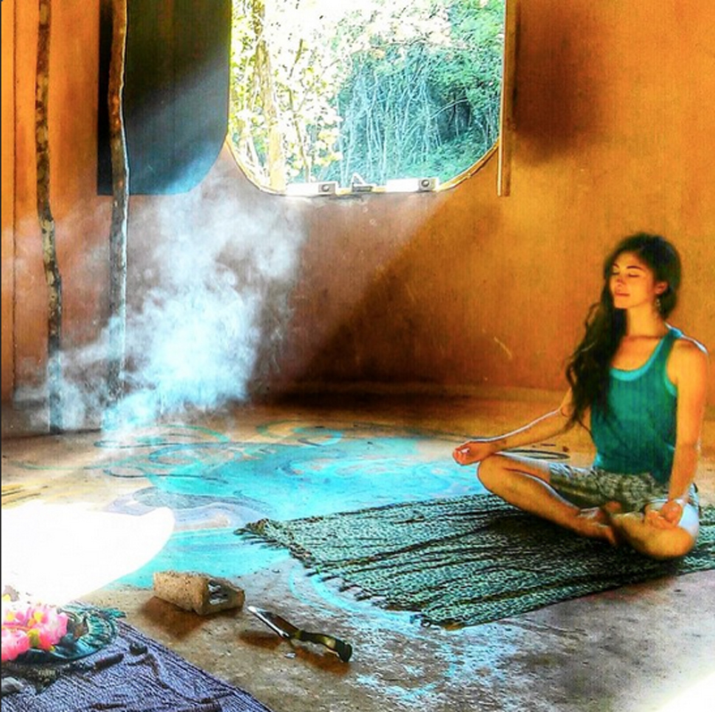 A Lemurian meditating inside the large palapa, a serene moment.
