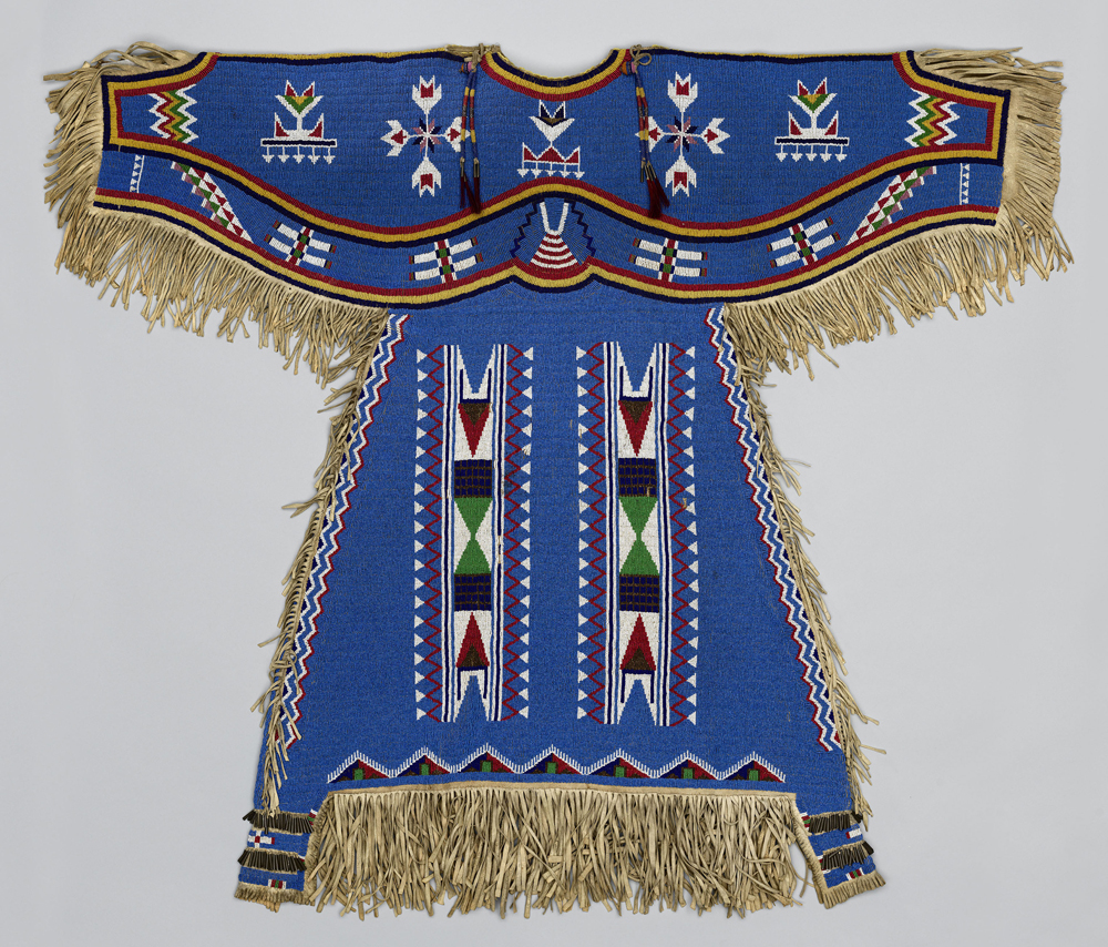 Woman's Dress, c. 1900. Dakota (Eastern Sioux), Yanktonai or Lakota (Teton Sioux) artist, Fort Peck Reservation (Montana). Native tanned leather, glass, brass and steel-cut beads, metal cones, horsehair 48 x 39 in. (121.9 x 99.1 cm). Washington (District of Columbia), Smithsonian Institution, National Museum of Natural History.