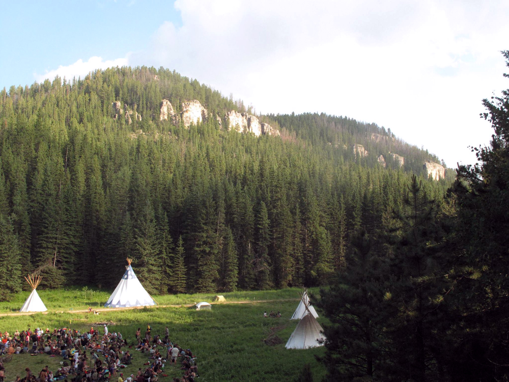 A view on the US Rainbow Gathering in the forested higlands of the Black Hills, South Dakota.