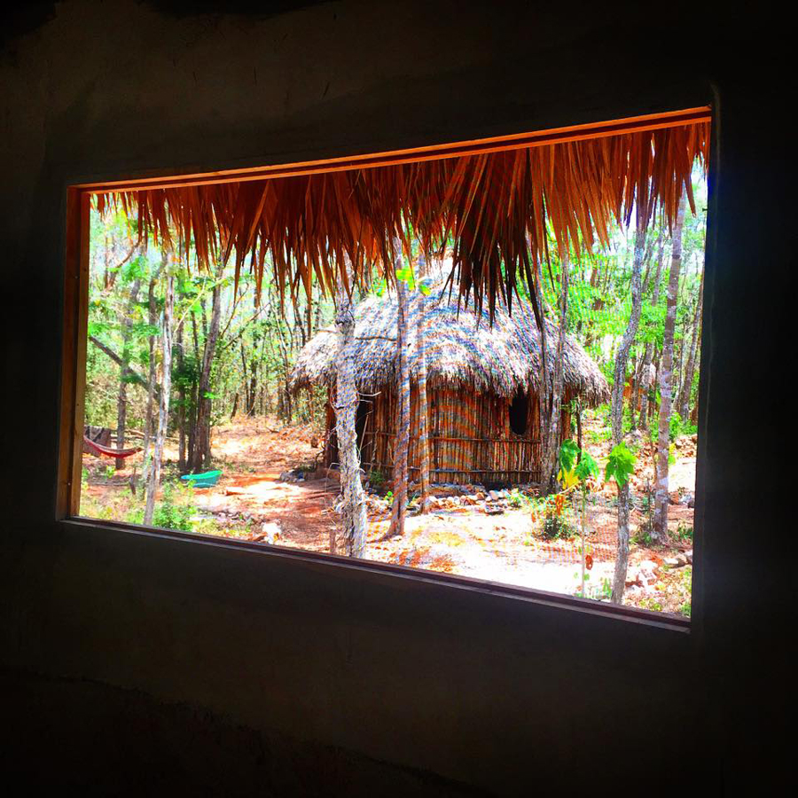 New Windows installed from mosquito mesh, insulating the jungle from our inside temple.